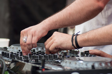 closeup of hands of mixer at dance floor in outdoor
