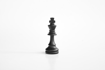 Black king chess piece in white isolated background