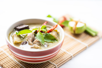 Green curry chicken (Kang Keaw Wan Gai) in a bowl with ingredients, Thai food