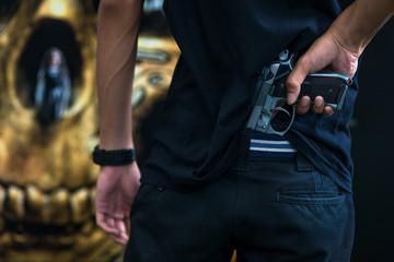 A man holding a gun in hand, the ship ready to shoot for self defense, Criminal concept.