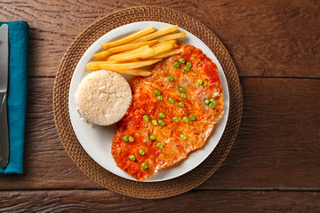 parmigiana meal with rice and french fries. top view