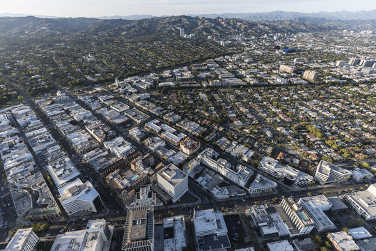 Aerial view of Beverly Hills California with West Hollywood, Los Angeles and the Santa Monica Mountains in background.