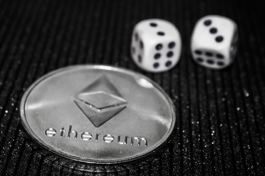 Coin cryptocurrency ethereum and rolling dice.
