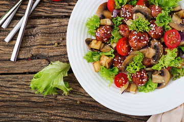 Salad with meatballs, eggplant, mushrooms and tomatoes in Asian style. Healthy food. Diet meal. Top view. Flat lay.