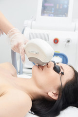 Laser hair removal. Medical procedure. Hair removal on the face. Bright skin