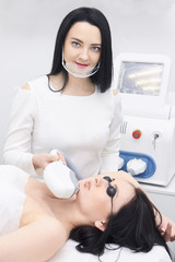 Young girls. Laser hair removal. Cosmetic procedure. Modern equipment