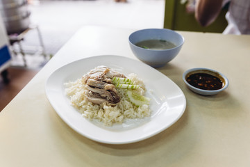 Hainanese chicken rice, Thai gourmet steamed chicken with rice served with sliced of cucumber and soup.
