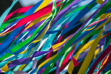 Multicolored ribbons on holiday as an abstract background