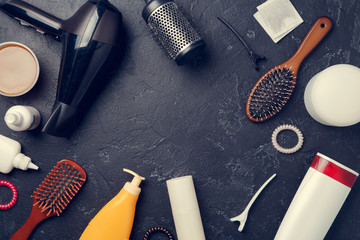 Image of hairdresser accessories, hair dryer, combs, in circle on empty black background,