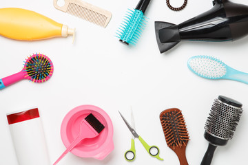 Photo of accessories hairdresser, hair dryer, combs located in circle on clean white background.