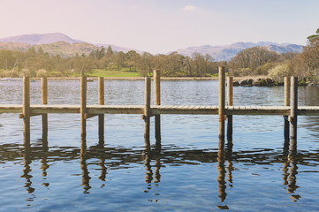 Waterhead Pier at Ambleside, a lakeside town situated at the head of Windermere Lake within the Lake District National Park in South Lakeland, England