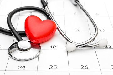 Calendar with stethoscope and red heart. Date for medical examining.