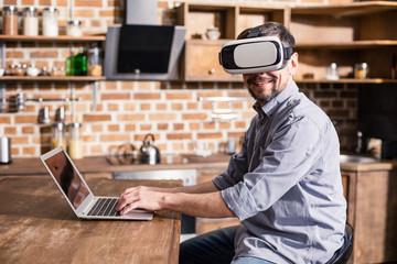 Successful businessman wearing VR glasses