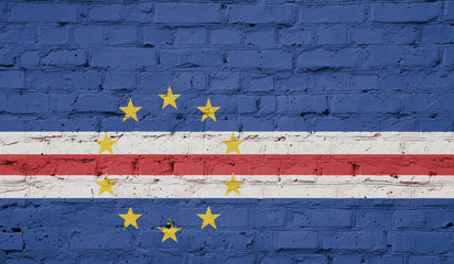 Texture of a flag of Republic of Cape Verde on a brick wall.