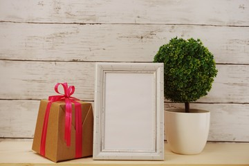 photo frame with gift box present and home decoration