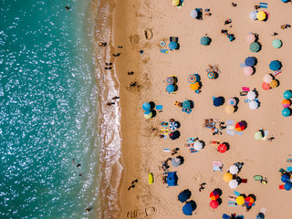 Aluminium Prints Beach Aerial View From Flying Drone Of People Crowd Relaxing On Algarve Beach In Portugal