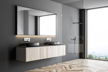 Double sink in a gray bathroom interior side view
