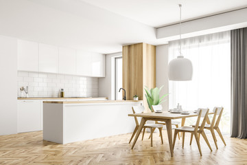 White and wooden kitchen corner, table