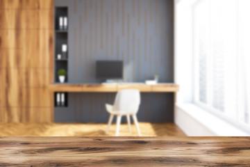 Loft home office interior, gray walls blur