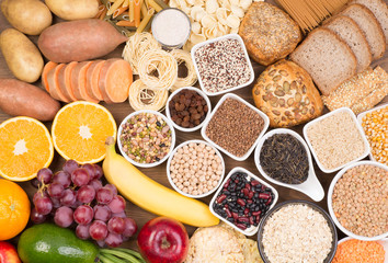 Carbohydrates food sources, top view on a table