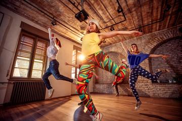 modern hip hop dancing girls in urban fitness center