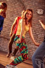 Smiling female hip-hop dancer performing