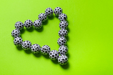 Heart made from  candies, football ball shaped