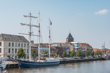 view of the city of kampen from the harbor with schooner netherlands holland Fototapete