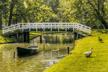 bridge and boat in the gardens surrounding the city of Kampen. netherlands holland Fototapete