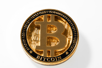 Gold metal coin bitcoin on white background close-up view from above. BTC. Bitcoin cryptocurrency. Anonymous. Virtual currency. Bright abstract background ideal for any design