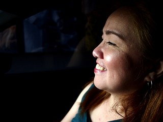 Asian woman inside a car