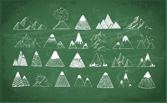 Doodle sketch mountains on blackboard background
