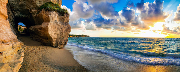 Tuinposter Strand amazing sea sunset in small hidden beach in Tropea, Calabria, Italy
