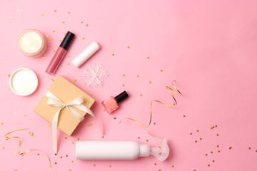 cosmetics and Christmas decor on a colored background top view. New Year's gift, Christmas.