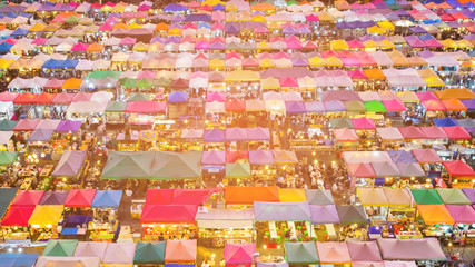 Night flea market roof top multiple colour, cityscape background