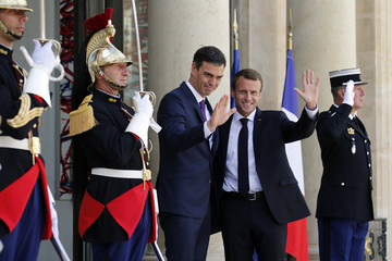 French President Emmanuel Macron greets Spain's Prime Minister Pedro Sanchez at the Elysee Palace in Paris