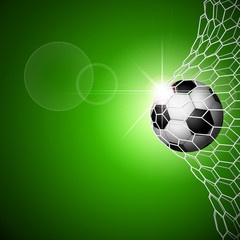 Soccer ball in goal. Green
