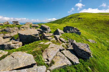 huge boulders on the edge of hillside. fine weather in summer mountain landscape