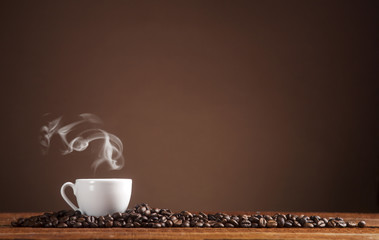 Coffee on a brown background with copy space