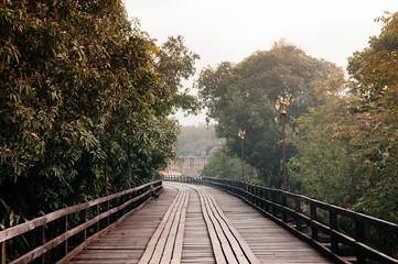 Wooden Mon bridge and big tree in Sangkhlaburi, Kanchanaburi, Thailand