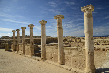 Row of ancient columns against blue sky background