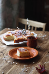 Sweet Rolls with Vanilla Pastry Cream, powdered with icing sugar, on wooden table.