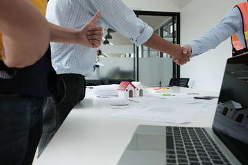 architect & customer shaking hands. Engineer handshaking with partner for successful deal in building project development. business teamwork concept