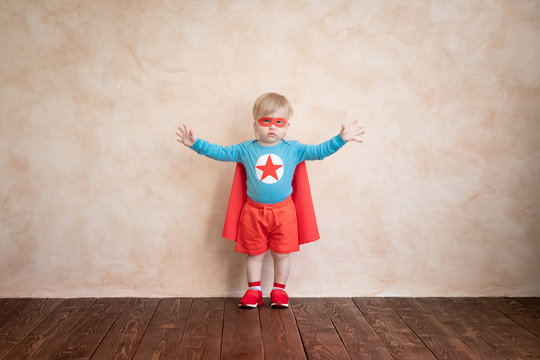 Superhero child playing at home