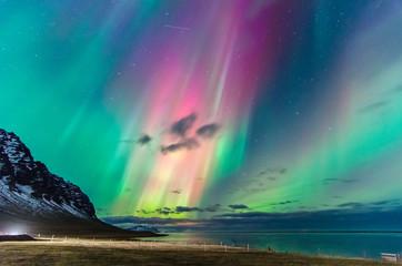 In de dag Noorderlicht Colorful northern lights over iceland sky