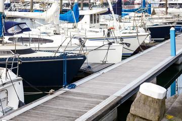 Yacht reflection north dock boat seaport sky blue sea background sunset port meny diffirent sunlight scheveningen den haag holland sailboat