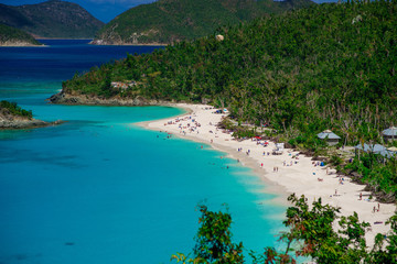 Beautiful beach with a lot of people and green hills foreground, St. John US Virgin Islands