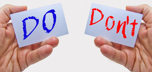 do and don't words hold on business man hands. things to do and not to do in emergency crisis