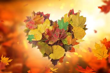 Herbsthintergrund Herz Blätter
