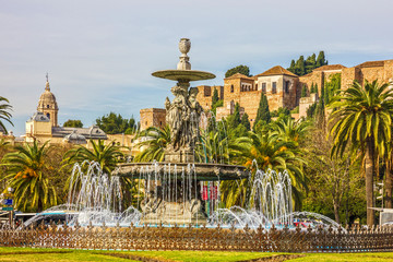 Malaga, Spain: Fountain and Alcazaba fortress.